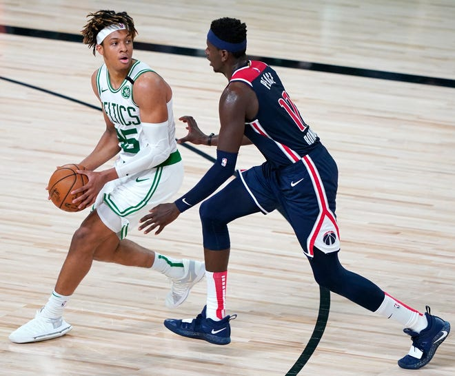 Celtics guard Romeo Langford looks to pass around the Washington Wizards' Isaac Bonga during a game last August in Lake Buena Vista, Fla.