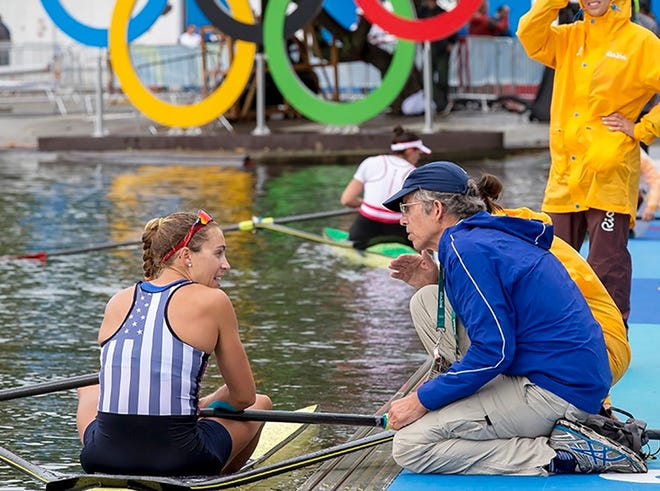 Gregg Stone talks to daughter Gevvie Stone after the single-scull semifinals at the 2016 Rio Olympics, where she won a silver medal.