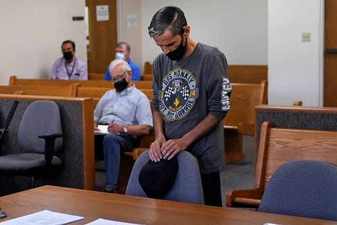Luis Vertentes, a tenant from East Providence, R.I., stands before Judge Walter Gorman during an eviction hearing, Monday, Aug. 2, 2021, in Providence. Rhode Island tenants facing eviction after the lifting of a federal moratorium on being ousted for unpaid rent plead their case in court. Vertentes agreed to leave his residence, which he has not paid rent on in four months, in about three weeks. (AP Photo/Charles Krupa)