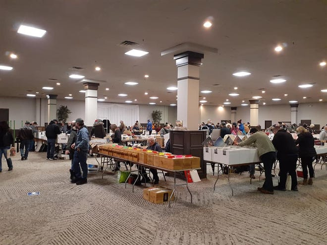 Customers search for records during the Feb. 14, 2021, South Bend Record Show. The event returns to Ramada by Wyndham on Sunday, Aug. 8, 2021.