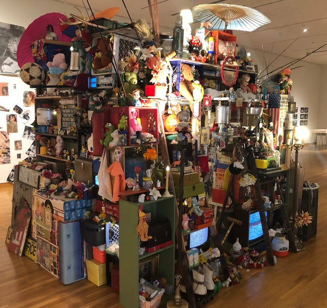 """Mandy Cano Villalobos of Grand Rapids used abandoned items to create this 10-foot cube piece in the """"Biennial 31"""" exhibit on display at the South Bend Museum of Art through Oct. 3."""