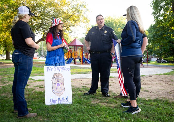 Springfield Police Chief Kenny Winslow visits with supporters that held up signs supporting the police during National Night Out hosted by the Iles Park Neighborhood Association at Iles Park in Springfield, Ill., Tuesday, August 3, 2021. Six neighborhoods hosted community events alongside the Springfield Police Department for the first National Night Out events in the city since 2019. The annual nationwide event promotes strengthening relationships between local police departments and the neighborhoods they serve. [Justin L. Fowler/The State Journal-Register]