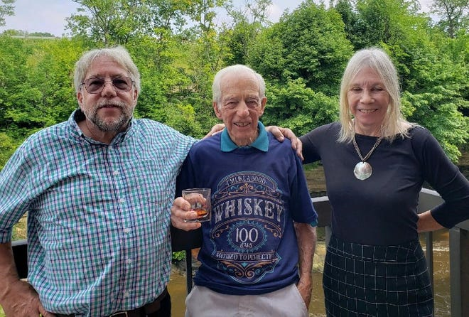 Leonard (Len) Grimsley and his son Kevin, who is 67, and his daughter Lynne, who is 73. Grimsley turned 100 on July 24.