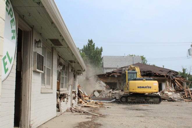 TW Construction of Bath continued demolition Wednesday of the Innkeeper Motel at 1111 Sixth Ave. S.E.