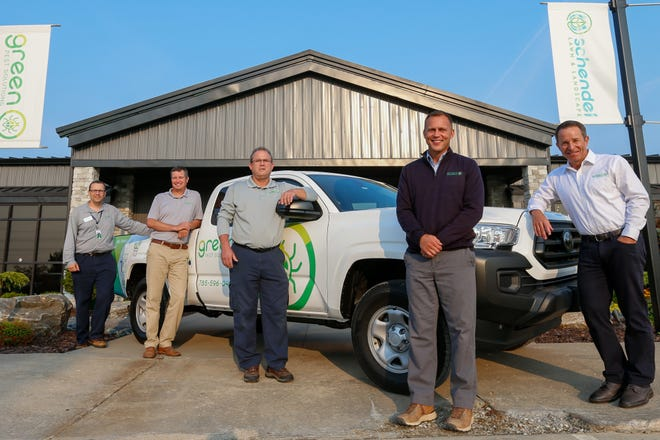From right, Brent Boles, Aaron Jones, Bryon Arb, Brandon Moore and James Whitney pose in front of the headquarters to Schendel Lawn & Landscape and Green Pest Solutions on Wednesday morning.