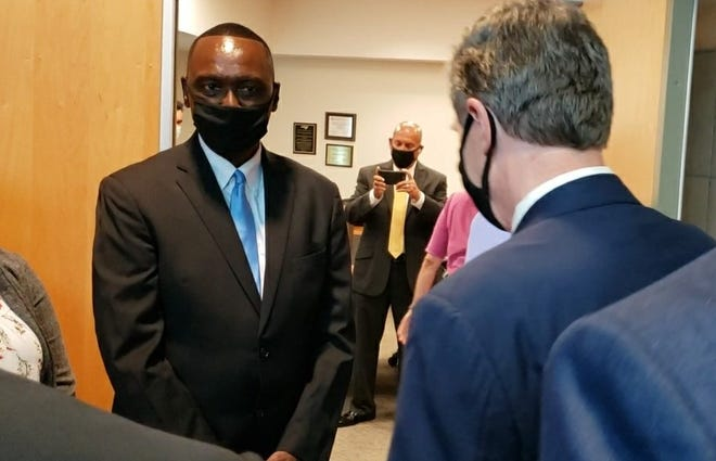 Charles Evans, left, chairman of the Cumberland County Commissioners, is among local officials who greeted NC Gov. Roy Cooper, who visited the COVID-19 vaccine clinic at the county Health Department on Tuesday.