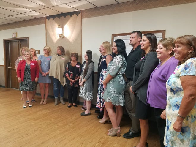 Those who won awards from the Twin City Chamber of Commerce on Tuesday gathered for a group photo.