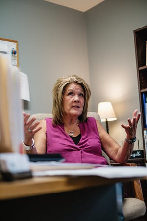 OhioGuidestone Executive Director Pam Trimmer talks about how a potential mental health staffing shortage may affect clients, Wednesday, Augst 4, in New Philadelphia.