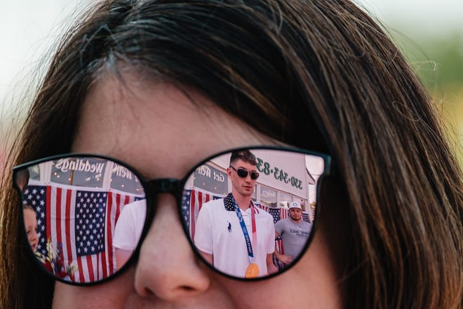 Hunter Armstrong and his brother, Jake (right) are reflected in the glasses of Jenny Mathias, from Dover, during a community meet and greet, Wednesday, August 4 at Pam's Posies in Dover, Ohio.