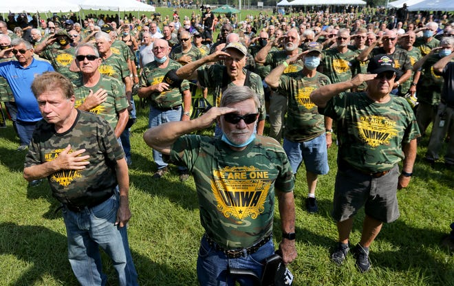 Earl Melton, center, is among many military veterans who are also miners saluting the flag during the national anthem at a rally supporting the United Mine Workers of America strike against Warrior Met Coal in Brookwood, Ala., Wednesday, Aug. 4, 2021. [Staff Photo/Gary Cosby Jr.]