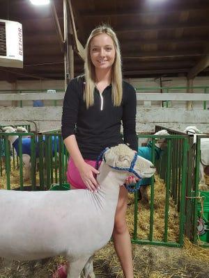 4-H veteran Hattie Dagel came to present her prize sheep at Achievement Days