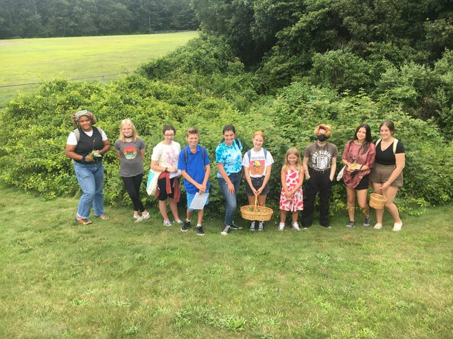Art students from Plymouth North and Plymouth South high schools worked on the art installation in class after collecting materials in the field.
