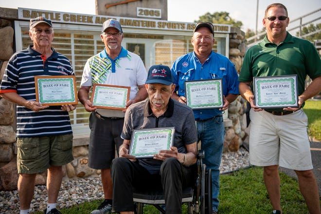 The 2021 Battle Creek-Area Association Armature Sports Wall of Fame inductees include Bruce Parson, Prince Gibson, Robert Moran, Mike Rupert and the DK Fence Co. Stan Evans, who was inducted in 2015, but could not attend the ceremony, was also honored and represented by family member Dave Rose, at left.