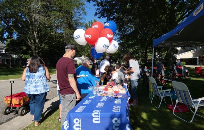 Mader Drive residents file past the food table during their National Night Out party.