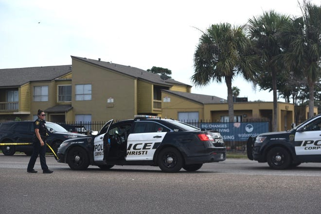 Corpus Christi police hang yellow crime scene tape outside an apartrment complex on the 5900 block of Weber Road, where officer Manuel Dominguez was shot by a suspect, Wednesday, Aug. 4, 2021. Dominguez was treated at a local hospital and was in stable condition late Wednesday.