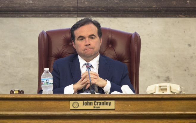 Cincinnati Mayor John Cranley presides as council members vote whether to approve or disapprove the severance package to keep City Manager Harry Black on March 28,2018. The package, supported by Mayor John Cranley, would have given Black $423,000 in salary and benefits to walk away. Council members voted 5-4 to keep Black.
