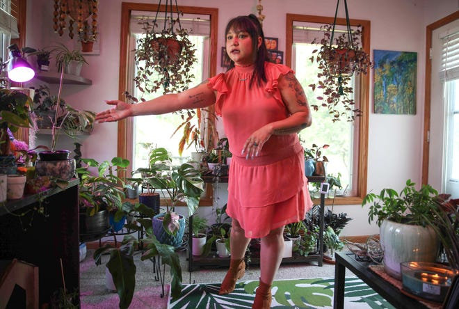 Temeshia Bomato talks about caring for her houseplants from the three-season room of her home in Urbandale on Wednesday, Aug. 4, 2021. Bomato is planning on opening a new plant store/bar in September.
