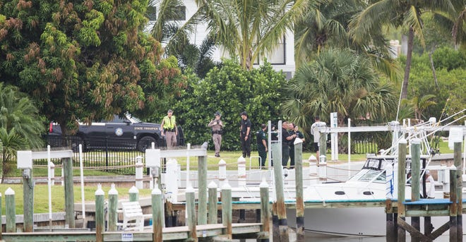 Members of law enforcement investigate the scene of a submerged vehicle on the south end of Fort Myers Beach on Wednesday, August 4, 2021. One person has been confirmed deceased.