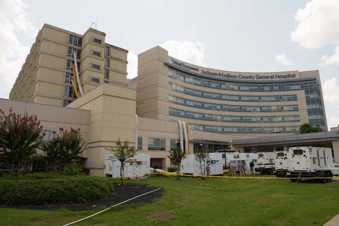 Ventilators emerge from windows at Jackson-Madison County General Hospital. There were 45 patients on a ventilator in the hospital on Wednesday, and 15 of them were COVID patients.