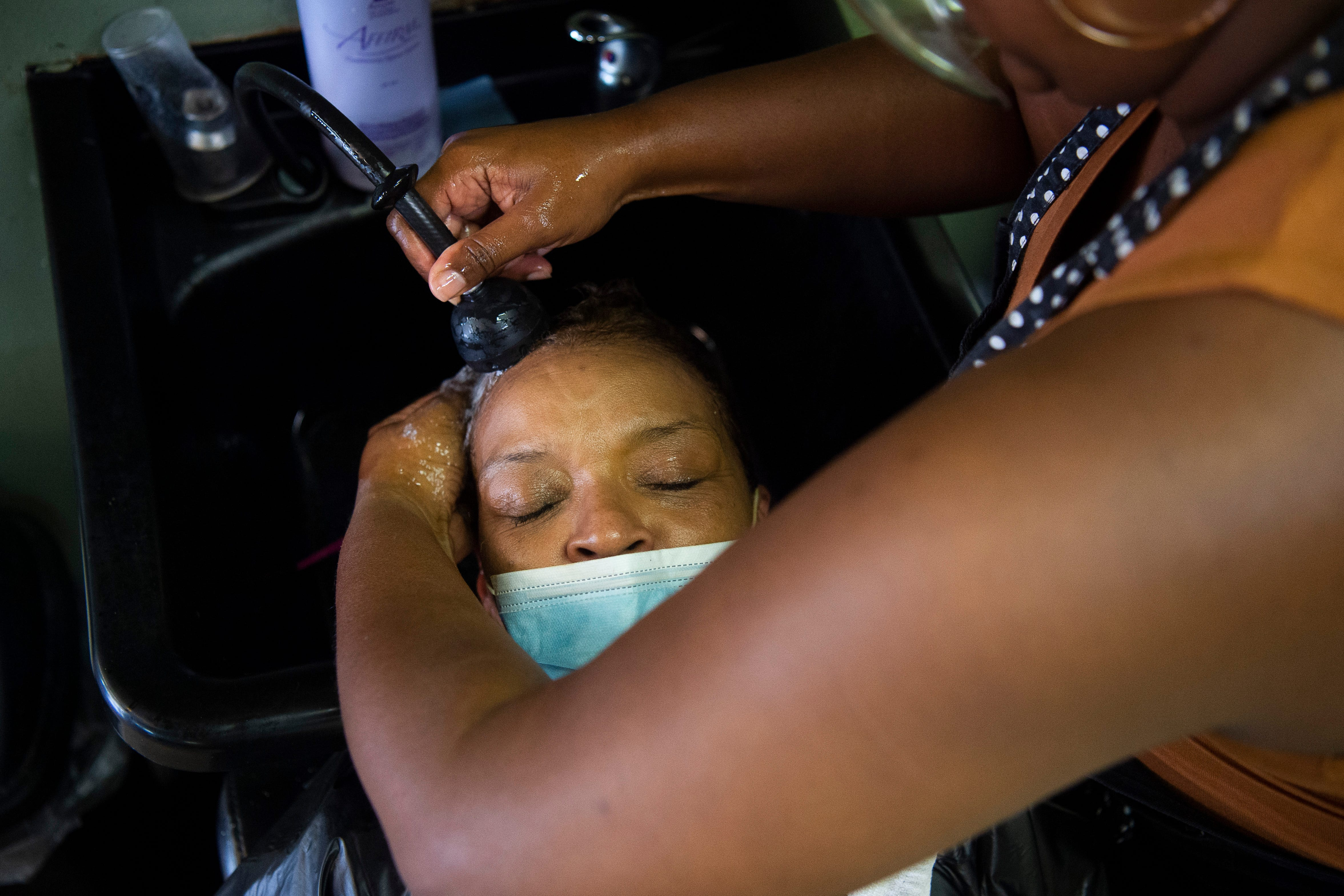 """Patricia Talford wanted a change with her hair, she said, """"and so in order to have a change I have to come to the best."""" Talford found out about Pure Essence Salon through her daughter and is thankful for owner Chanta Barfield's ability to make customers feel comfortable in the chair."""