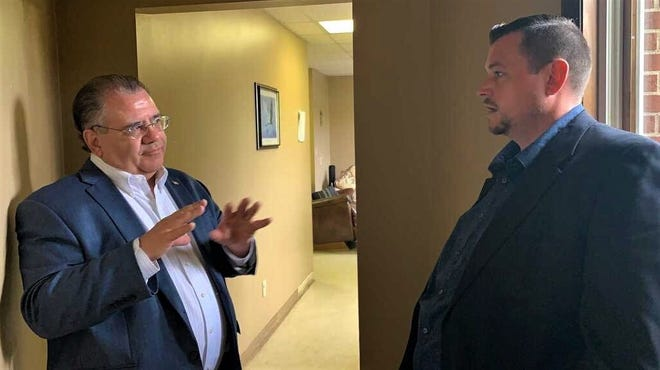 Ohio Senator Tim Schaffer, left, talks with Mike Wells, the Refuge Ministries' Lancaster site director, during a tour of the facility July 14. The senator helped secure funding for the addiction treatment ministry's new dormitory.