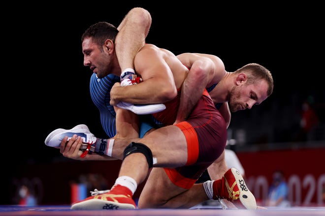 Brighton's Myles Amine (foreground), competing for San Marino, wrestles David Taylor of the United States in the men's freestyle 86-kilogram quarterfinals at the Olympic Games on Wednesday, Aug. 4, 2021 in Chiba, Japan.