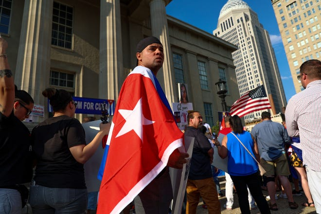 Dozens of Louisville's Cuban community demonstrates outside Metro Hall to bring attention to Cuba's historic July protests and seek more U.S. involvement.