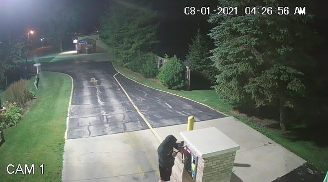Suspect in coin machine entry in Manitowoc caught on video surveillance Aug. 1, 2021.