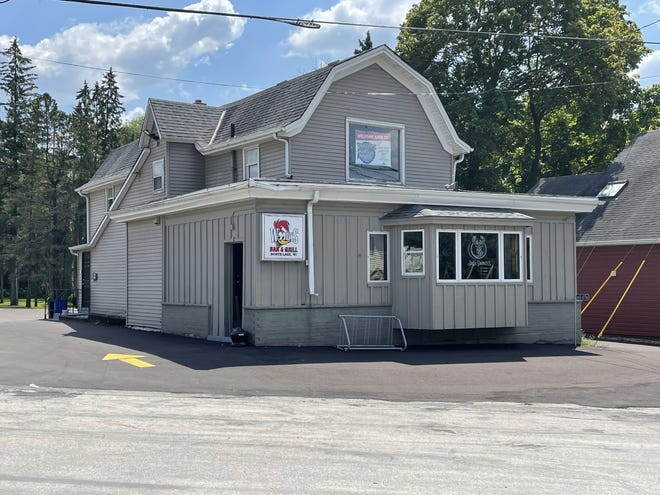 Woody's Bar and Grill in the town of Merton has reopened after two new owners took over.