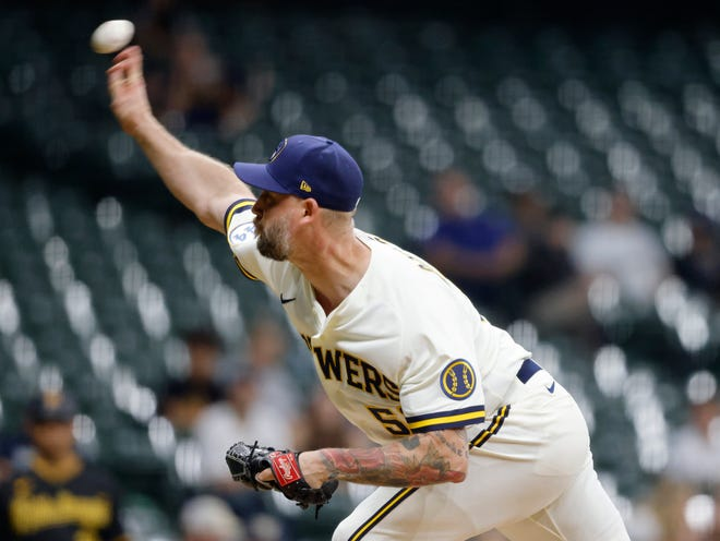 John Axford experienced elbow pain in his first outing since returning to the Brewers on Monday but the extent of the injury is still not known.
