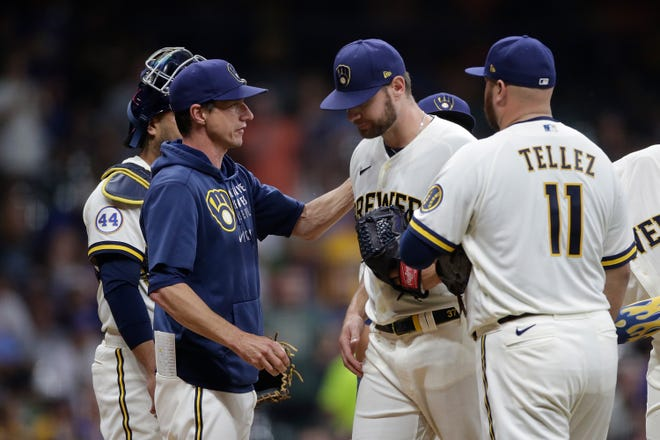 MILWAUKEE, WISCONSIN - AUGUST 03: Adrian Houser #37 of the Milwaukee Brewers leaves the game in the seventh inning with a no hitter against the Pittsburgh Pirates at American Family Field on August 03, 2021 in Milwaukee, Wisconsin. (Photo by John Fisher/Getty Images)