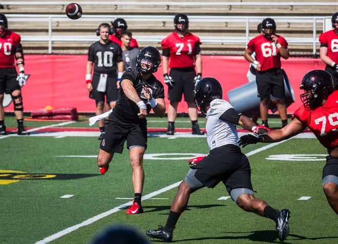 Ball State quarterback Drew Plitt throws a pass during the Cardinals' first fall practice at Scheumann Stadium Wednesday, Aug. 4, 2021.