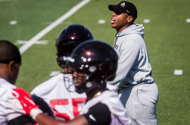 Ball State defensive coordinator yells toward his the defense during the Cardinals' first fall practice at Scheumann Stadium Wednesday, Aug. 4, 2021.