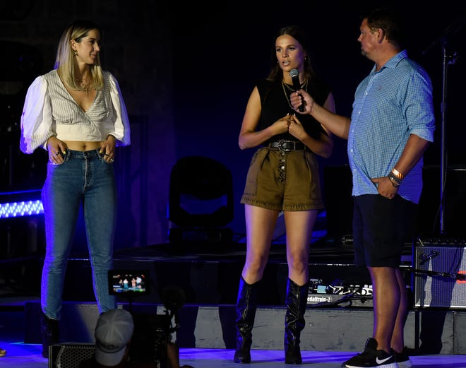 Feeding Nashville founders Taylin Lewan, center, and Hayley Hubbard speak during the Feeding Nashville Concert at the FirstBank Amphitheater on Tuesday, August 3, 2021, at Graystone Quarry in ThompsonÕs Station, Tenn.