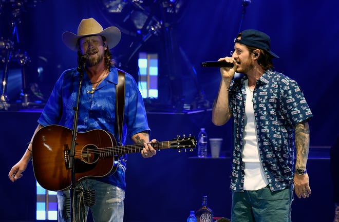 Brian Kelley and Tyler Hubbard of Florida Georgia Line perform during the Feeding Nashville Concert on Aug. 3. The band announced it was canceling its tour due to COVID-19 concerns.