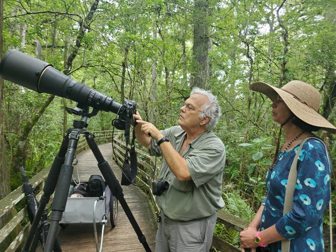 Photographer RJ Wiley, left, with Corkscrew Swamp Sancturary Director Lisa Korte, PhD.