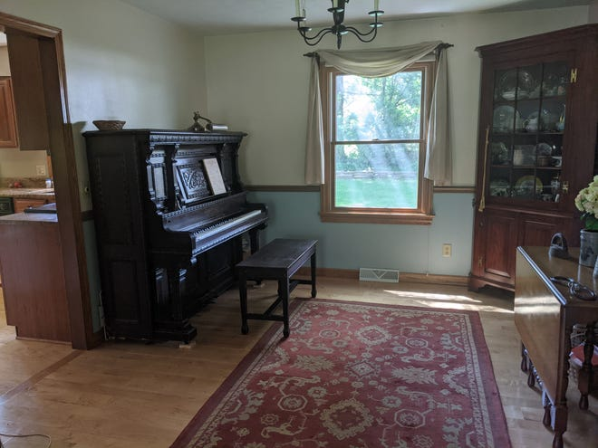 A piano in Abbey's childhood home.