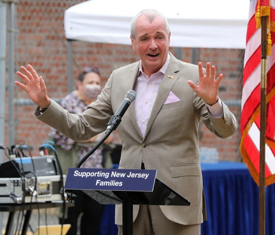 Gov. Phil Murphy signs S3691 in Union City Aug. 4, 2021. The bill ends the eviction moratorium for higher income families on Aug. 31, and on Dec. 31 for lower income families