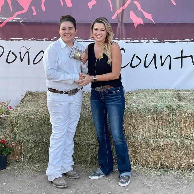 Lacey Knight of Doña Ana County is presented with theHeritage buckle award from Sen. Crystal Diamond, R-Elephant Butte, on behalf of the New Mexico Cattle Growers' Association for her generational commitment to agriculture.