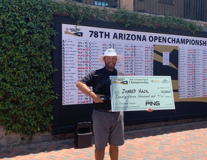 Jhared Hack stands with his check and trophy after the final round of the 78th Arizona Open Championship on Aug. 4, 2021.