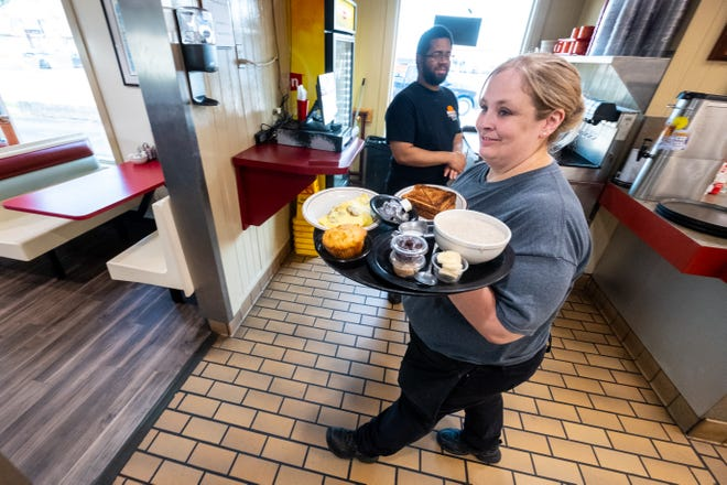 Daybreak Cafe server Lisa Wilson prepares food Wednesday, Aug. 4, 2021, at the restaurant in Port Huron. Owner Bill Wilson said about 50% of his business was from Canadians before the pandemic closed the border.