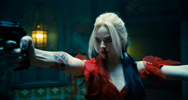"""Margot Robbie stars in """"The Suicide Squad."""" The movie opens Friday at Regal West Manchester, Queensgate Movies 13 and Hanover Movies 16."""