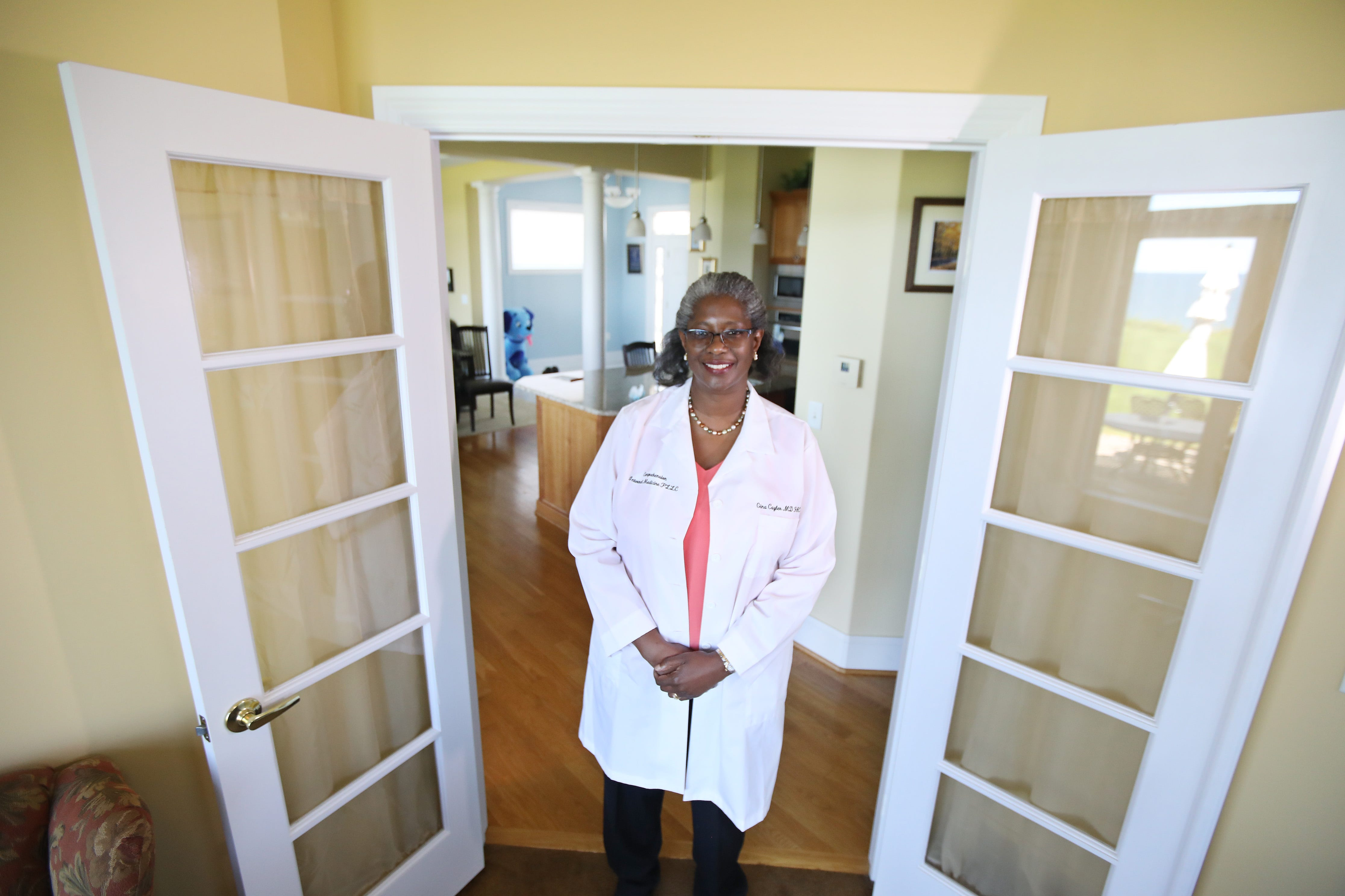 Dr. Gina Cuyler works in her home office in Rochester, N.Y. Dr. Cuyler co-founded the Black Physicians Network of Greater Rochester as a way to help mentor and support medical students who are from underrepresented communities of color.