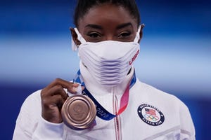 Simone Biles, of the United States, poses with her bronze medal after balance beam competition during the artistic gymnastics women's apparatus final at the 2020 Summer Olympics, Tuesday, Aug. 3, 2021, in Tokyo, Japan.