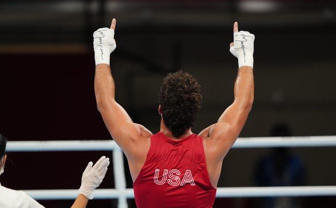 Tulare's Richard Torrez Jr (USA) celebrates after defeating Kamshybek Kunkabayev (KAZ) in a men's super heavy 91kg semifinal during the Tokyo 2020 Olympic Summer Games at Kokugikan Arena. Mandatory Credit: Kareem Elgazzar-USA TODAY Sports