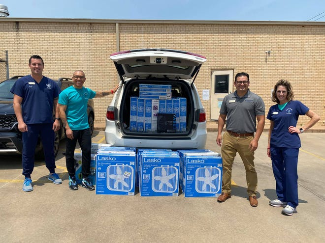 Healing Hands donated 100 fans to Interfaith Ministries for distribution to those in need.