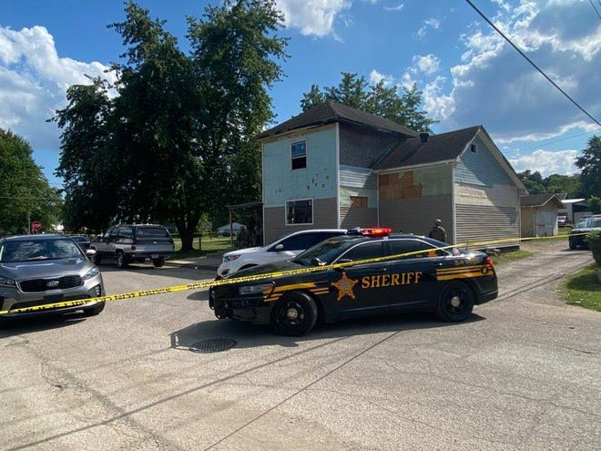 Officer conduct a search warrant at a suspected drug house located at 255 Mead St. in Zanesville Tuesday afternoon.