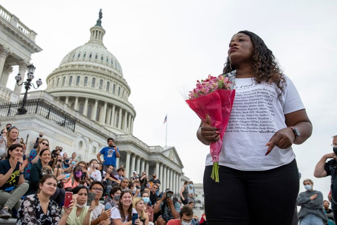 Rep. Cori Bush, D-Mo., addresses a sit-in on Capitol Hill on Aug. 3, 2021, after it was announced that the Biden administration will enact a targeted nationwide eviction moratorium.