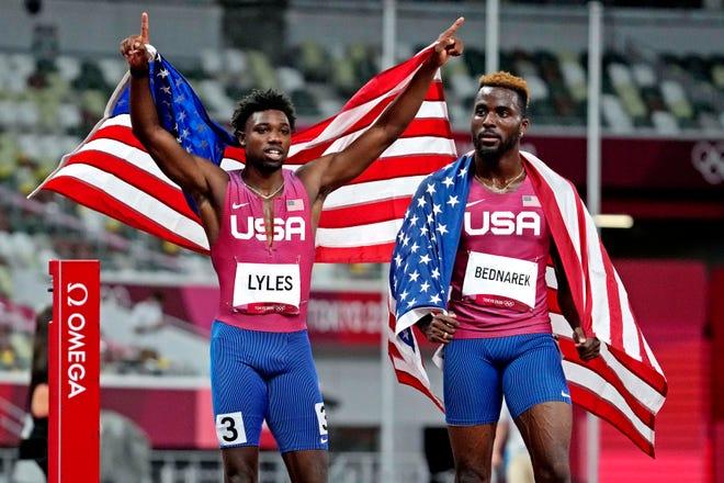 Aug. 4: Noah Lyles (left) celebrates winning the bronze medal and Kenneth Bednarek celebrates winning the silver medal in the men's 200-meter final.