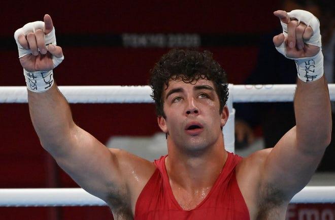 USA's Richard Torrez Jr. celebrates after winning against Kazakhstan's Kamshybek Kunkabayev after their men's super heavy semifinal boxing match.